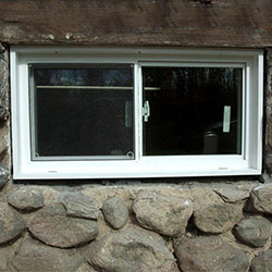 An energy efficient double-paned window installed in a basement in Revere.