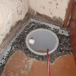 Installing a sump in a sump pump liner in a Cambridge home