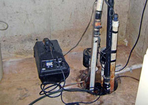 Pedestal sump pump system installed in a home in Arlington