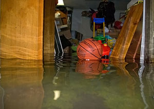 A flooded basement bedroom in Dracut