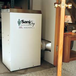 A basement dehumidifier with an ENERGY STAR® rating ducting dry air into a finished area of the basement  in Billerica