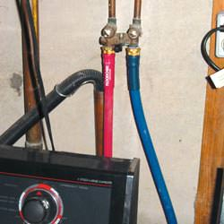 Washer hoses in a basement  in North Andover
