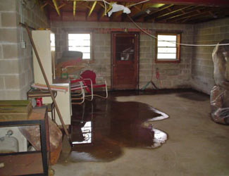 a flooded basement floor in a Billerica home