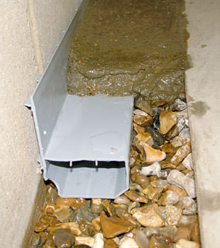 A basement drain system installed in a Framingham home
