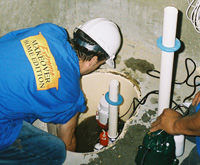 installing a sump pump and backup sump pump system in Melrose, MA